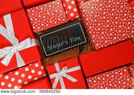 Online Shopping Of China, 11.11 Single's Day Sale Concept. The Red Gift Boxes On Yellow Background W