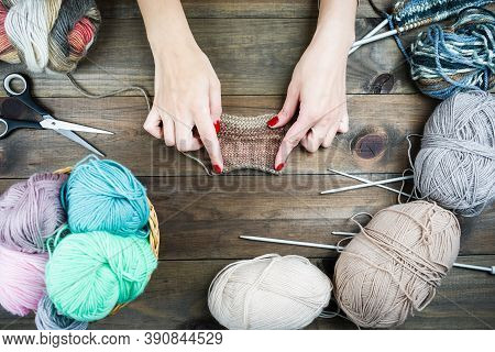 Close-up Of Hands Knitting. Colorful Threads. Selection Of Colorful Yarn Wool. Knitting Background.