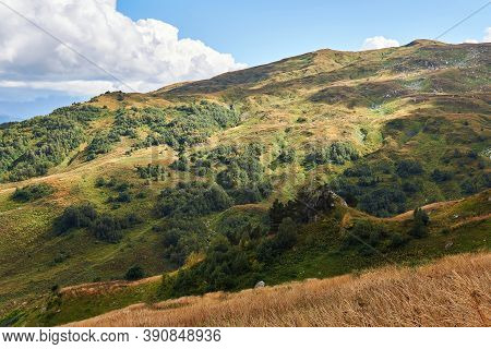 View From The Autumn Slope Of The Mountain With Glades, Copses And Shadows Of Clouds