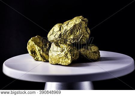 Gold Stone On Electronic Scale. Metal Used In Industry. Mineral Extraction Concept.