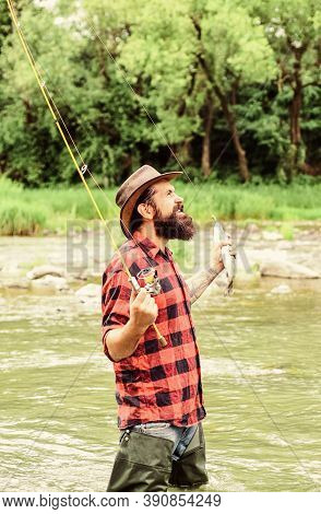 Fishing Masculine Hobby. Fishing Requires You To Be Mindful And Fully Present In Moment. Fisher Fish