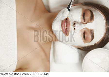 Spa Face Peeling Mask, Spa Beauty Treatment, Skin Care. Woman Getting Facial Care By Beautician At S