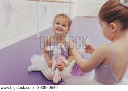 Happy Little Cute Girl Wearing Tutu And Leotard Laughing Joyfully, Enjoying Ballet Lesson At Dance S