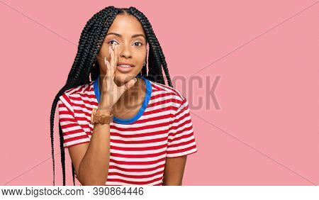 Beautiful hispanic woman wearing casual clothes hand on mouth telling secret rumor, whispering malicious talk conversation