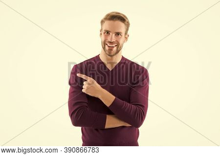 Smiling Handsome Man In Cardigan Pointing Finger. Space For Design. Caucasian Sexy Man. Business Adv
