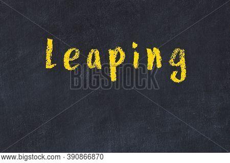 Chalk Handwritten Inscription Leaping On Black Desk