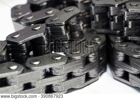 Timing chain of an engine of a modern car. Macro photography. Individual links of the chain are in f