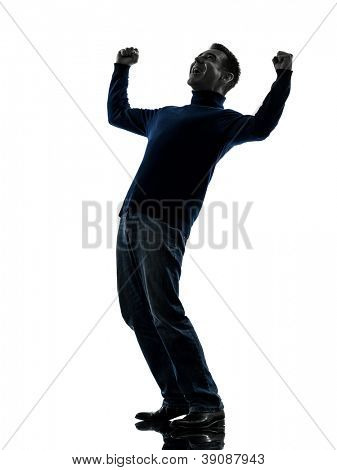 one causasian man happy stong victorious full length in silhouette studio isolated on white background