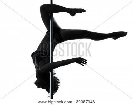 one causasian woman pole dancer dancing scorpion posture in silhouette studio isolated on white background