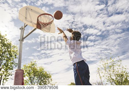 Cute Afro American Players Playing Basketball Outdoors