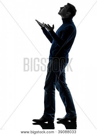 one causasian man looking up happy  full length in silhouette studio isolated on white background