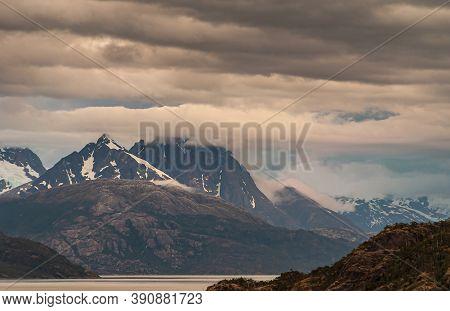 Sarmiento Channel, Chile - December 11, 2008: Amalia Glacier And Fjord. Brown And Gray Cloudscape Co