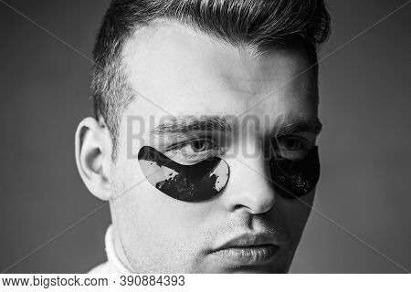 Man Face With Flakes Under The Eyes. Mans Flakes. Patches Under Close Eyes For Man. Acupressure, Mas