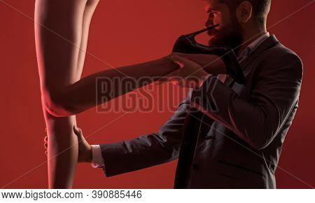 Erotica And Sexual Entertainment. Bearded Man Holding Sexy Womans Leg And Looking At Naked Buttocks,