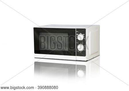 White Microwave Oven Isolated On White Background With Shadow Reflection Fade Out