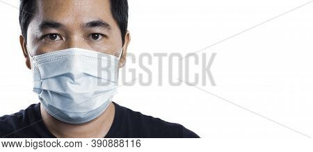 Asian Man Isolated Wearing A Disposable Face Mask On A White Color Background With A Right Side Copy