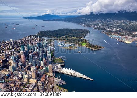 Aerial View Of Downtown Vancouver, Coal Harbour And Stanley Park. Taken During A Bright Sunny Mornin