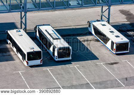 Airport Buses At The Parking Near Passenger Boarding Bridge