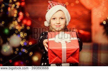 Nothing Warms The Heart Like Giving Xmas Gift. Happy Little Girl Giving Xmas Present. Small Child Ho