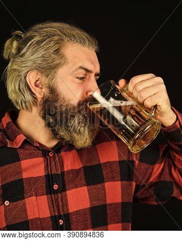Tasting A Draft Beer. Brutal Hipster Drink Beer. Mature Bearded Barman Hold Glass. Confident Bartend
