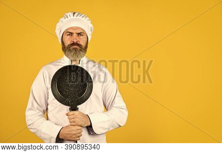 Healthy Food Cooking. Cooking Tasty Dish. Bearded Man Hold Frying Pan. Cooking In Pot. For Preparing