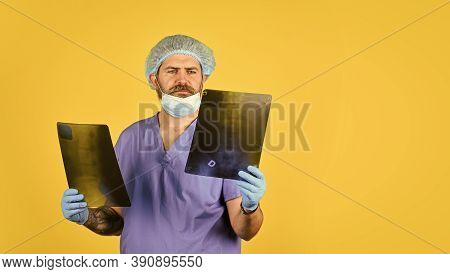 X-ray Concept. X Ray Radiation. The Doctor Holds Pictures Of Bones. Fracture And Bone Damage. Doctor