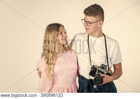 Boy And Girl In Casual Wear With Vintage Photo Camera. Retro Photographing. Students Photographer Ch