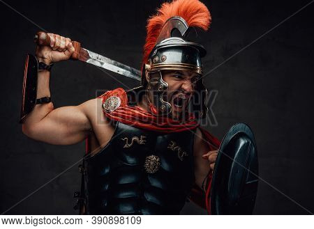 Attacking Savage And Brutal Imperial Soldier From Rome In Steel Armour And Red Cloak Holding Sword A