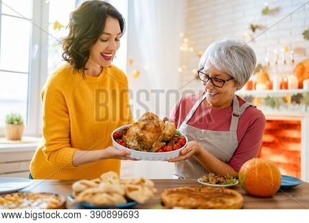 Happy Thanksgiving Day! Autumn feast. Family preparing traditional dinner.