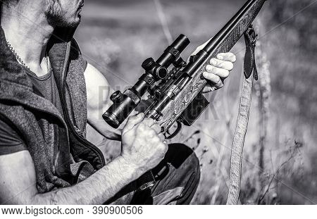 Hunter Is Aiming. The Man Is On The Hunt. Hunting Period. Male With A Gun. Close Up. Hunter With Hun