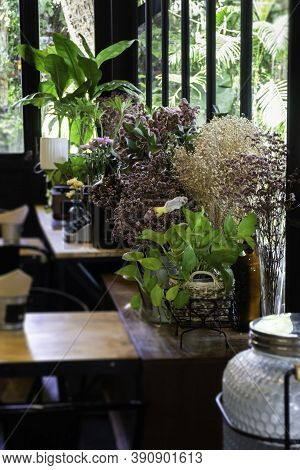 Dried Flower Arrangement In Coffee Shop, Stock Photo
