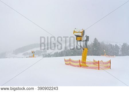 Modern Snow Cannon On A Ski Slope At Snowstorm