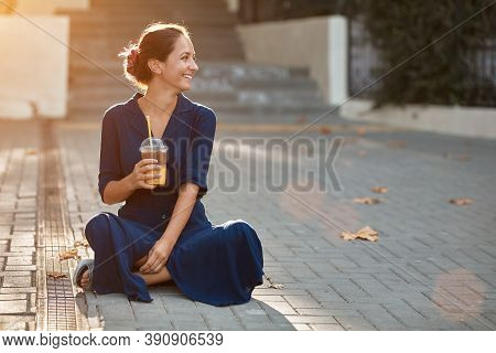Take Break And Coffee Time Concept, Copy Space. Attractive Woman In Blue Dress Sitting On Ground. Sp