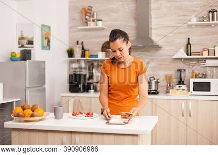 Woman Spreading Butter With Knife On Toasted Bread For Breakfast. Knife Smearing Soft Butter On Slic