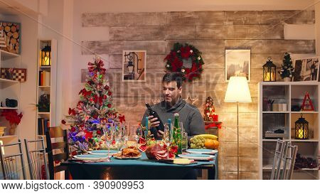 Caucasian Husband And Wife Welcoming Grandparents For Christmas Celebration. Greeting Grandparents,