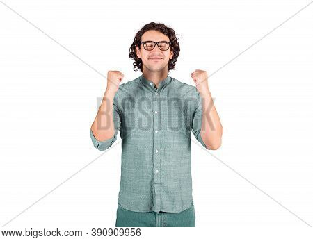 Thankful And Pleased Young Man, Long Curly Hair Style Wears Glasses, Keeps Fists Tight Raised Up, Ey