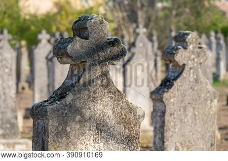 Tombstone And Graves In An Ancient Graveyard