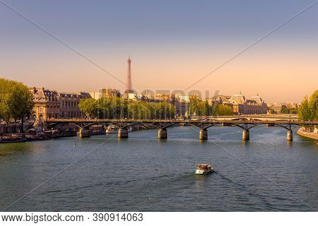 Sunset In The Seine River With The Eiffel Tower In The Background