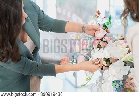 Woman Florist On Wedding Makes Flower Composition For Bride And Groom From Roses, Tulips, Peonies, O