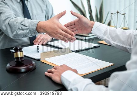 Male Lawyer Shaking Hands With Client After Good Deal Negotiation Cooperation Meeting In Courtroom.