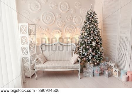 Living Room Interior With White Sofa Decorated Chic Christmas Tree, Gifts, Pillows. Xmas Interior Wi