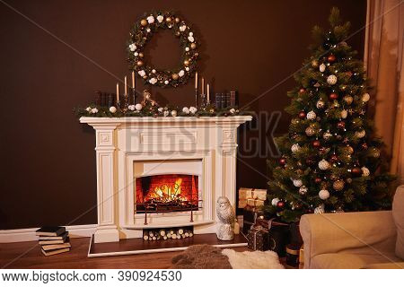 Christmas Tree With Beautiful Balls In A Cozy Brown Living Room With A Fireplase. Christmas Room Int