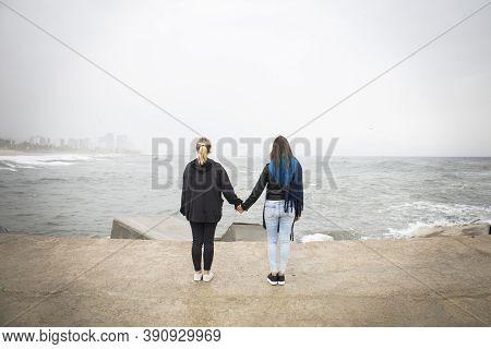 Couple Of Two Unrecognizable Young Woman Holding Hands. Friendship Concept. Gay, Lgbt And Homosexual