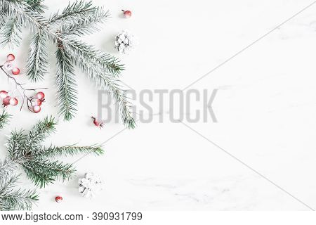 Christmas Composition. Fir Tree Branches On Marble Background. Christmas, Winter, New Year Concept.