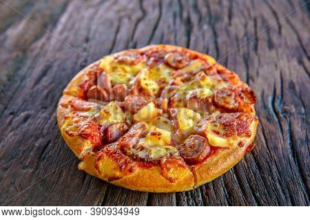Hot Pizza Served On Old Table. Delicious Pizza Served On Wooden Plate