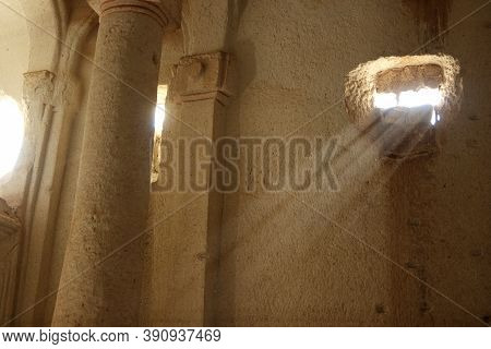 Interior Of An Ancient Cave Church At Cappadocia. Early Christian Rock Cave Church In The Tuff Rock.