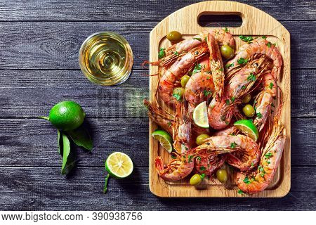 Jumbo Shrimps Cooked On A Skillet With Lime Fresh Parsley, Minced Garlic White Wine, And Butter Of B