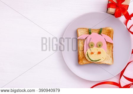 Funny Sandwich With Edible Symbol Of 2021 Bull Cow Made From Toast Bread, Sausage And Cheese. Breakf