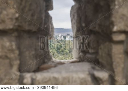 Window Embrasure In An Old Abandoned Fortress Focus On The Church
