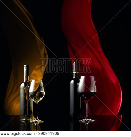 Red And White Wine On A Black Reflective Background. Copy Space.